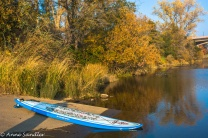 A paddle board ready for its rider.