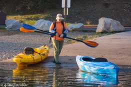 This woman came in on the blue kayak. I'm not sure who owns the yellow one.