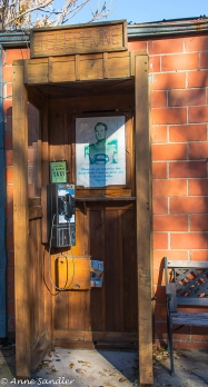 An old phone booth. The flyer posted is Superman asking visitors not to damage the booth because he has no other place to change his clothes!