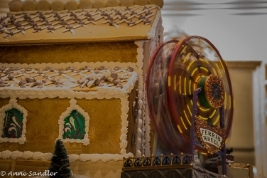 The spinning Ferris Wheel attached to a gingerbread house.
