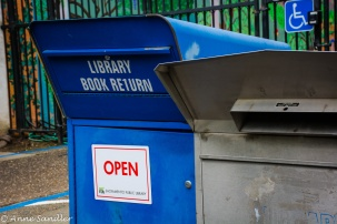 Book return boxes are located along side of the driveway.
