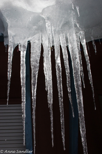 Icicles hanging from a roof.