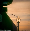 A street lamp and the setting sun.