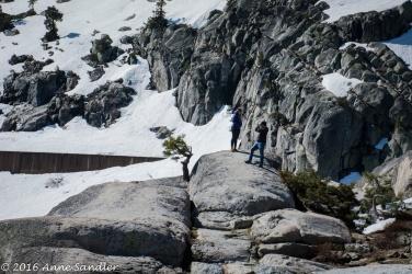 Snow is still on surrounding rocks.