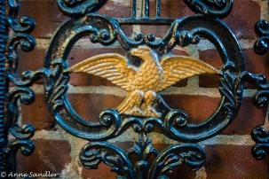 An emblem on a gate.
