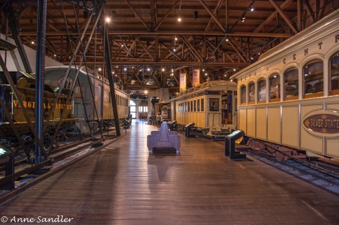 The main room of the museum. Just a few cars are open for people to walk through.