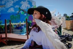 Another candid. I don't know why she had the feather in her mouth.