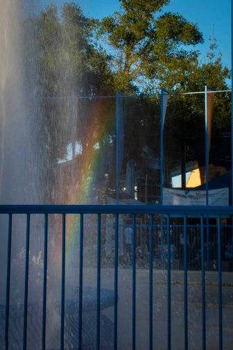 A rainbow in a fountain.