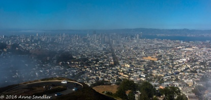The city view with foggy patches from the Twin Peaks parking lot.
