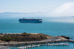 A ship coming through the bay.