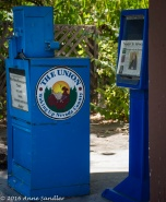 A newspaper box at the post office.