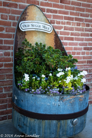 This wine barrel and sign welcomes you inside.