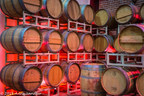 I loved how the red light cast on these barrels inside a winery room.