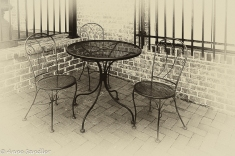 A table and chairs outside a restaurant.