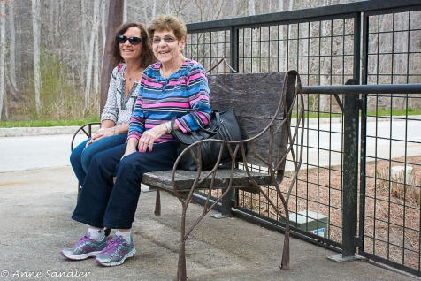 Roberta and Brenda sit on a matching designed bench.