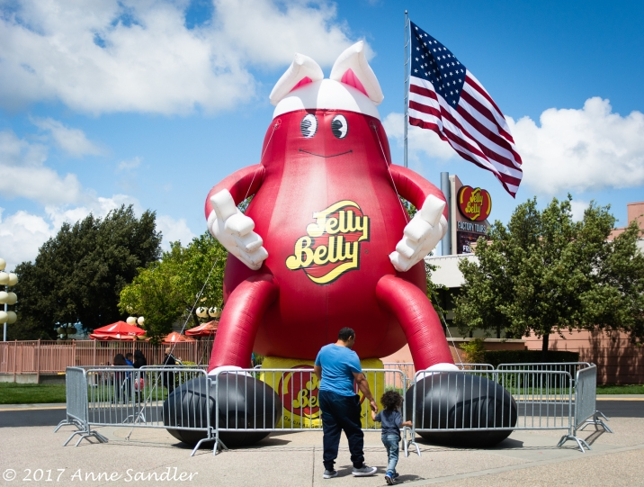 A dad and daughter gaze at the giant jelly bean outside the entry.