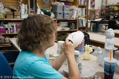 Our hostess, Sally, is painting her vase.