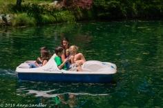 Paddle boating on the lake.