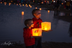 Boys are posing with their lanterns.