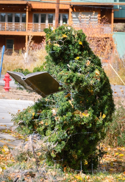 A book worm topiary in the back of the town's library.